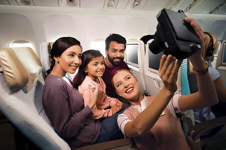emirates-b777-economy-class-families-selfie-photo-720x480